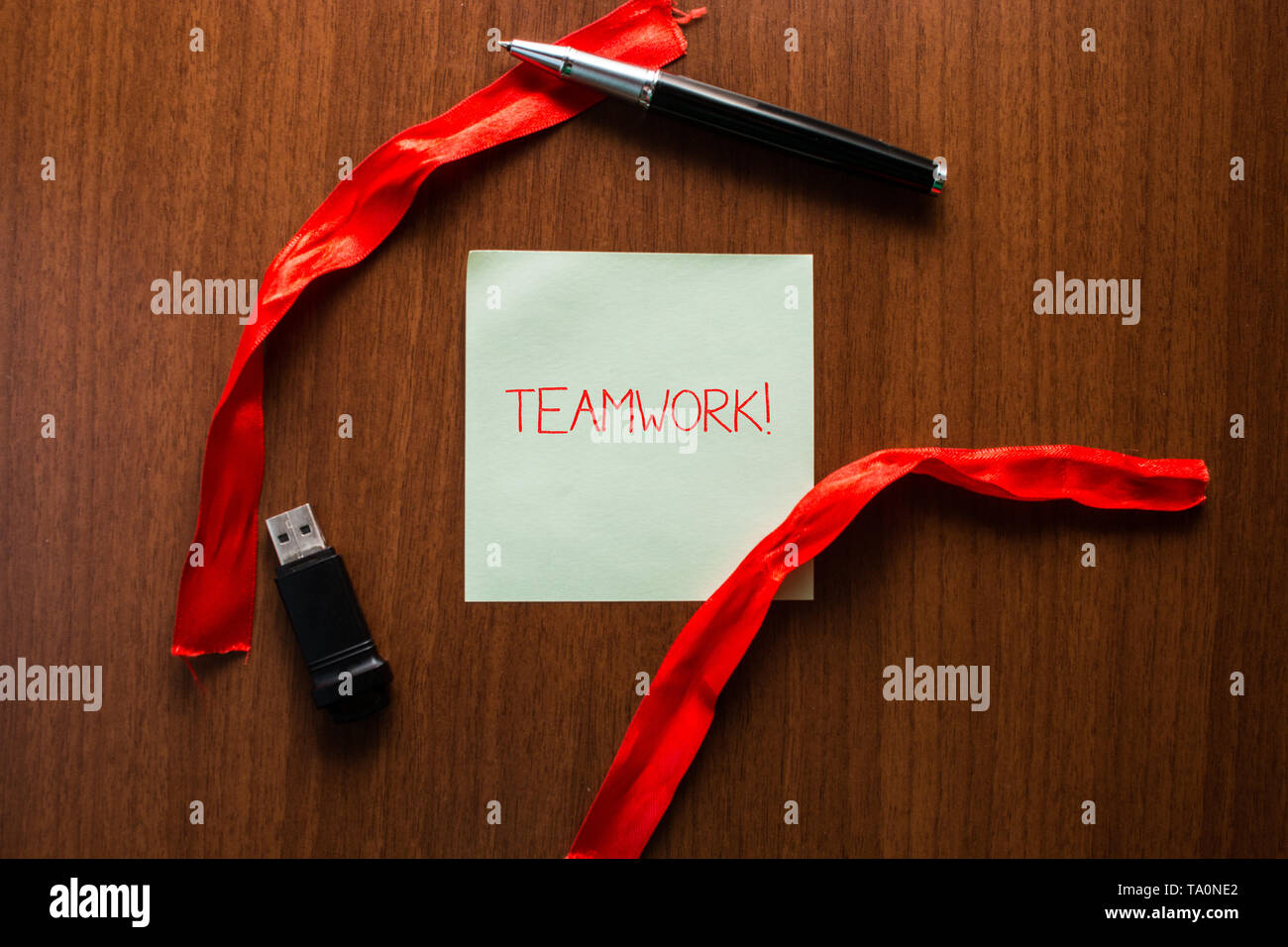 Text sign showing Teamwork. Business photo showcasing combined action of group especially when effective and efficient USB memory lying wooden table s - Stock Image