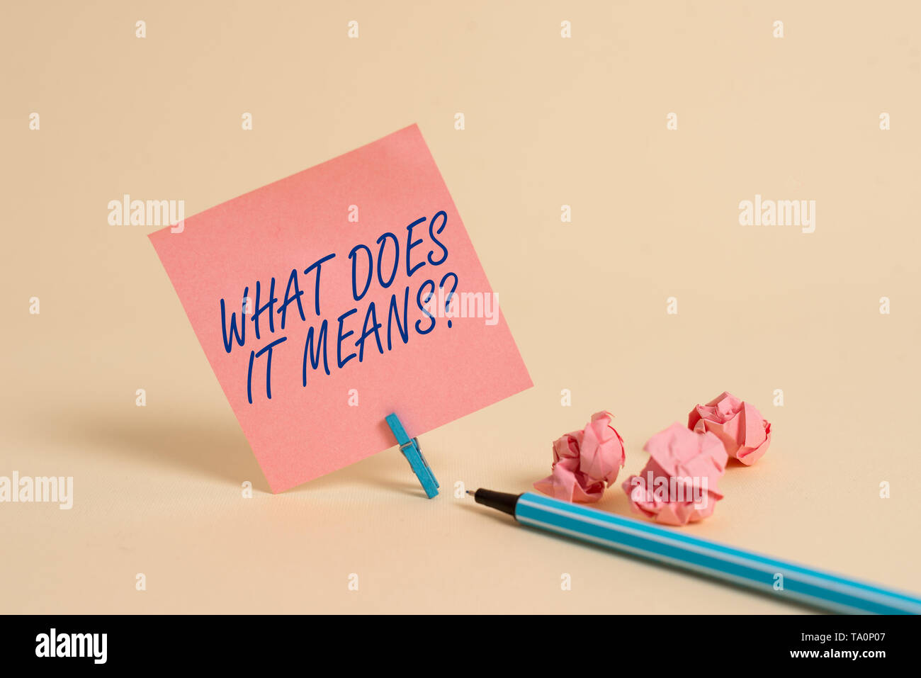 Conceptual hand writing showing What Does It Means Question. Concept meaning asking meaning something said and do not understand - Stock Image