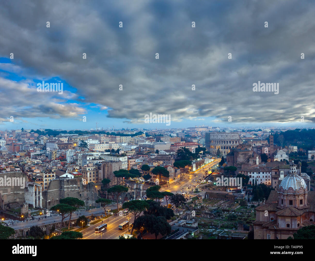 Ruins of Roman Forum. Rome City evening view from II Vittoriano top, Italy. People are unrecognizable. Multi shots stitch panorama. - Stock Image