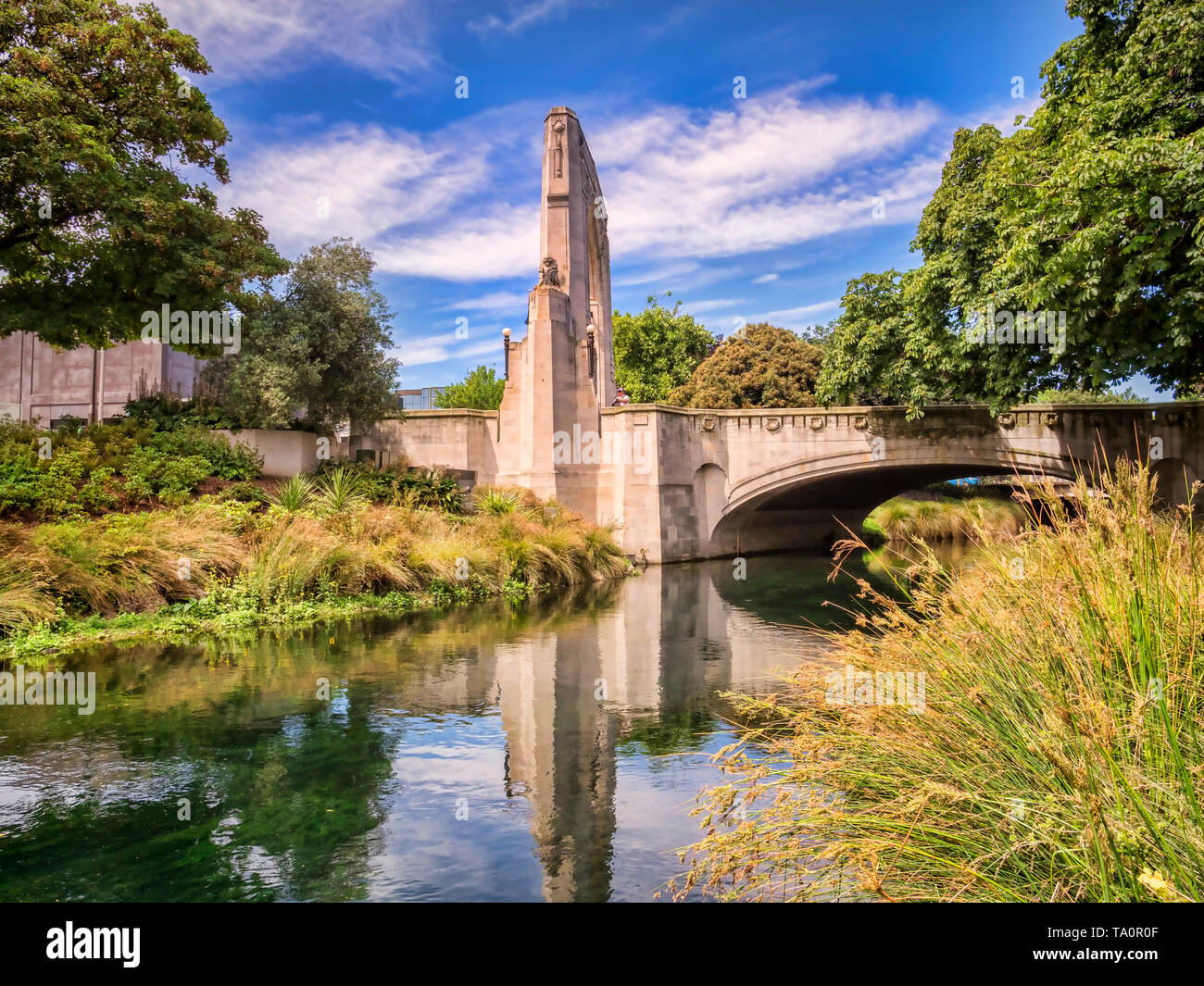 The Bridge of Remembrance and Cashel Street Bridge in the centre of Christchurch, New Zealand, reflected in the River Avon. Stock Photo