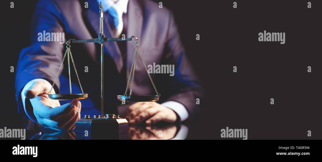 Weight scale of justice, lawyer or attorney concept. Unrecognizable person studio shot, copy space web banner background - Stock Image