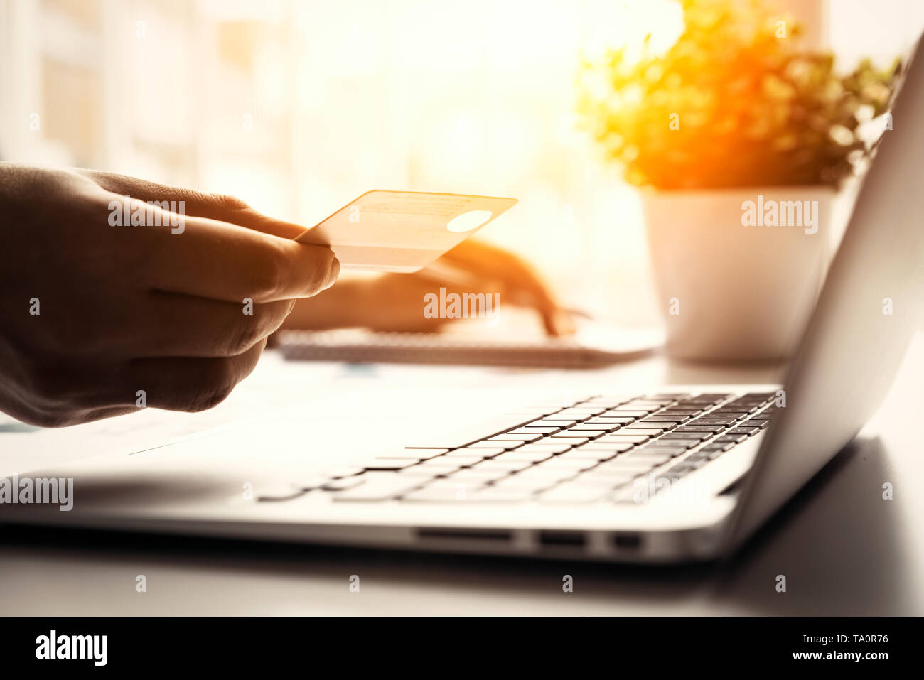Man using credit card while internet shopping. Credit card online payment concept. - Stock Image