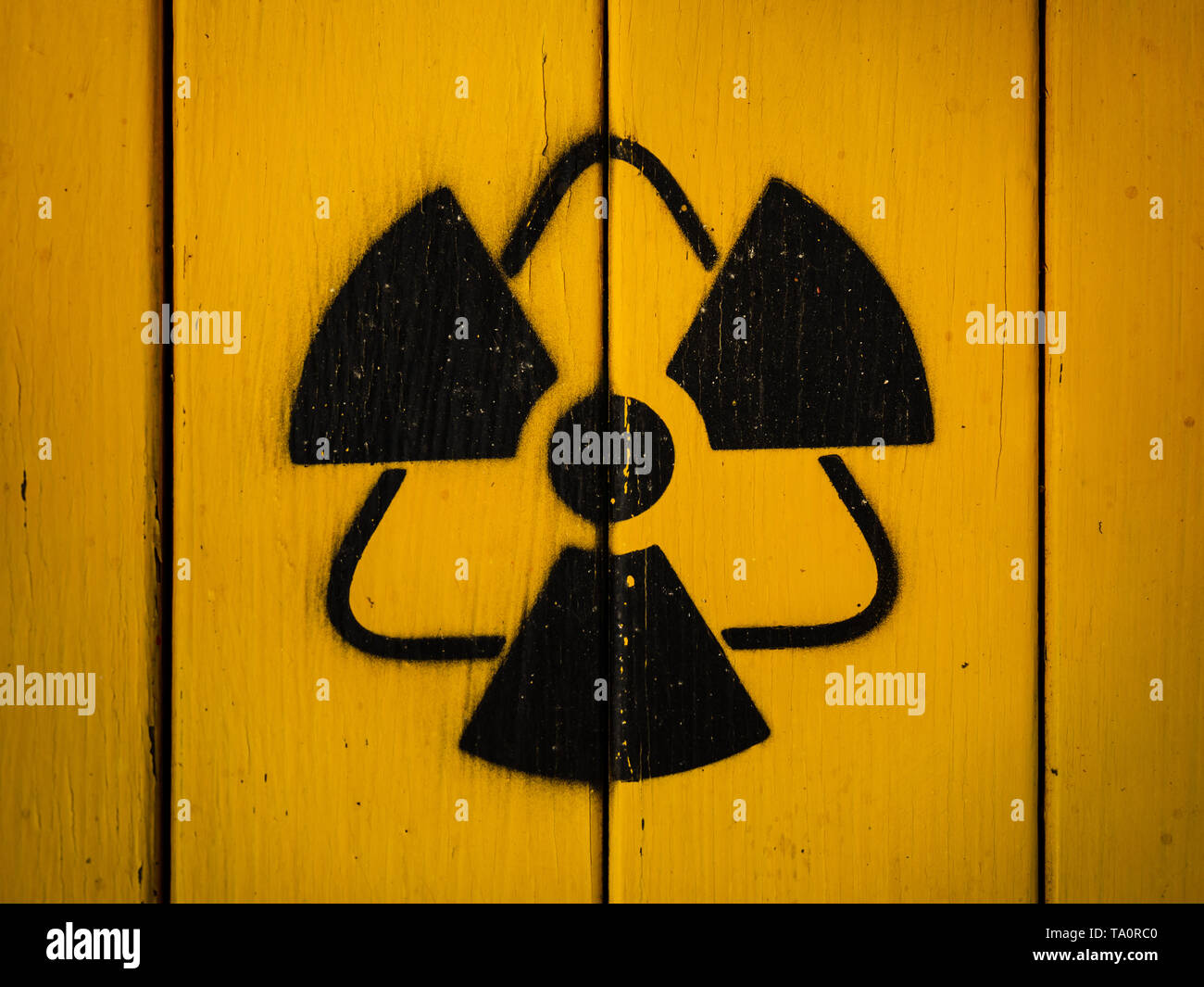 Sign of radiation on a yellow wooden board. Stock Photo