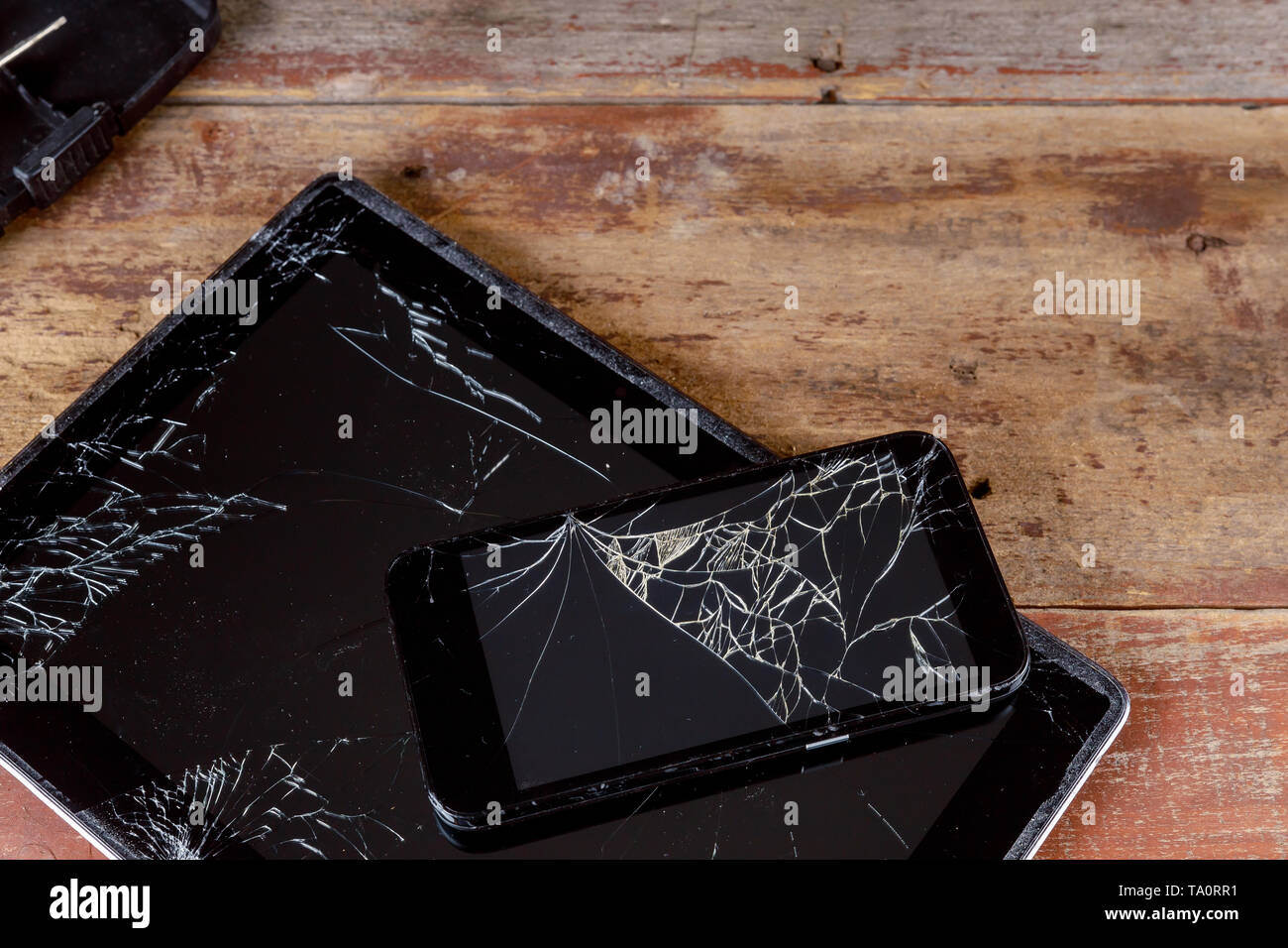 Broken glass screen on the touch screen electronic device smart phone and tablet - Stock Image