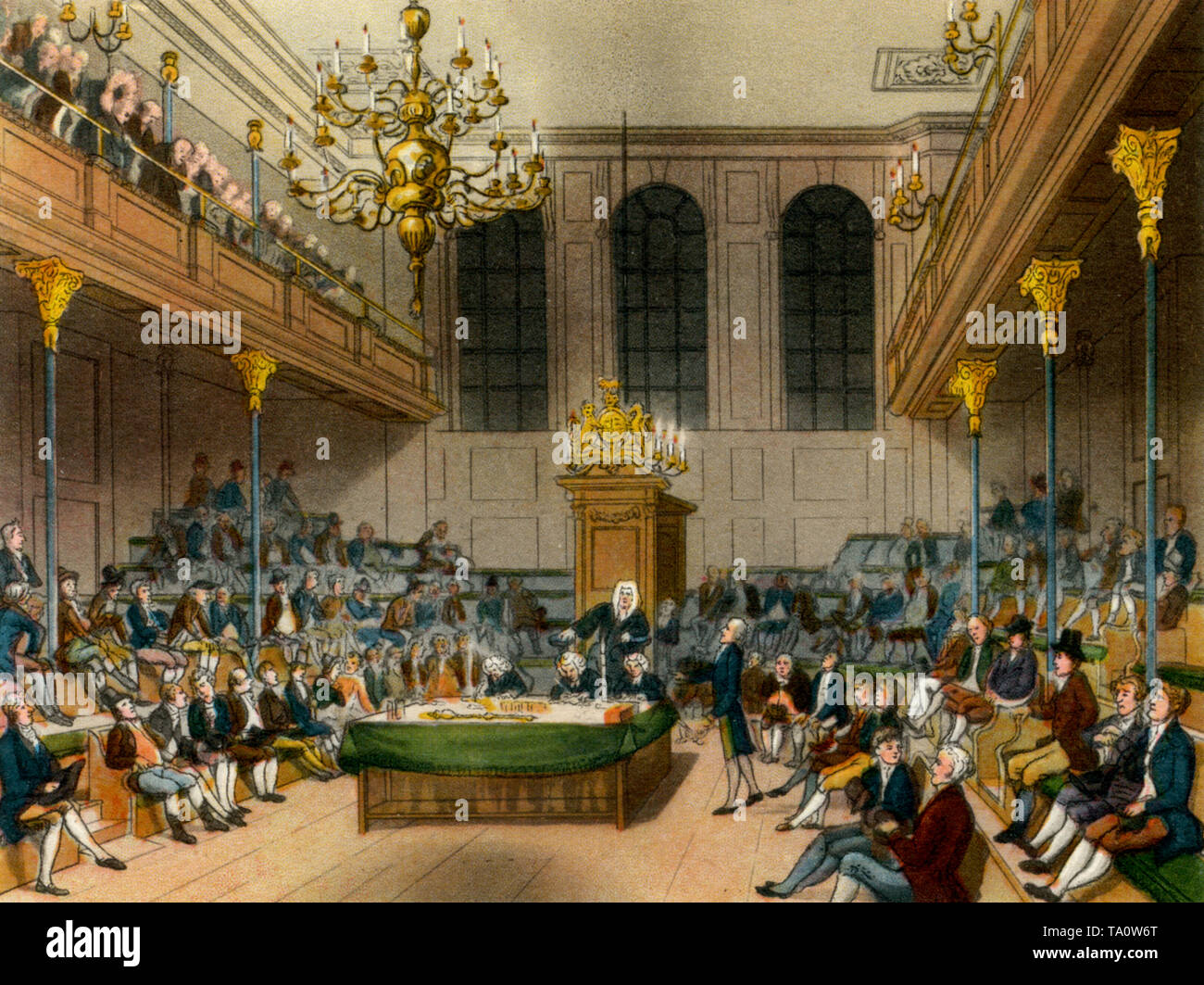 House of Commons, c1808-1810. A print from 'The Microcosm of London', by William Henry Pyne (1770-1843). Artists: Thomas Rowlandson (1756 – 1827) and Auguste Charles Pugin (1762–1832). The medieval Commons Chamber seen here prior to its destruction by fire in 1834. The new Palace of Westminster was partly designed by Auguste Charles Pugin's son, Augustus Welby Pugin (1812-1852). - Stock Image