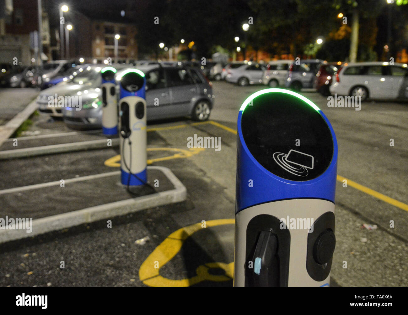 Turin, Italy, Piedmont 9 June 2018. Night view of an electric car rental station, parking with fast charging points. Blue Turin Society. - Stock Image