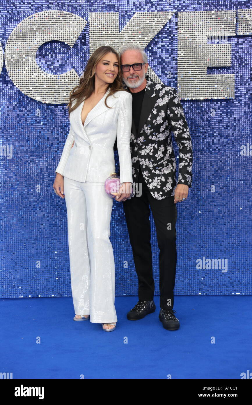 LONDON - MAY 20, 2019: Patrick Cox and Elizabeth Hurley attends the Rocketman film premiere Stock Photo