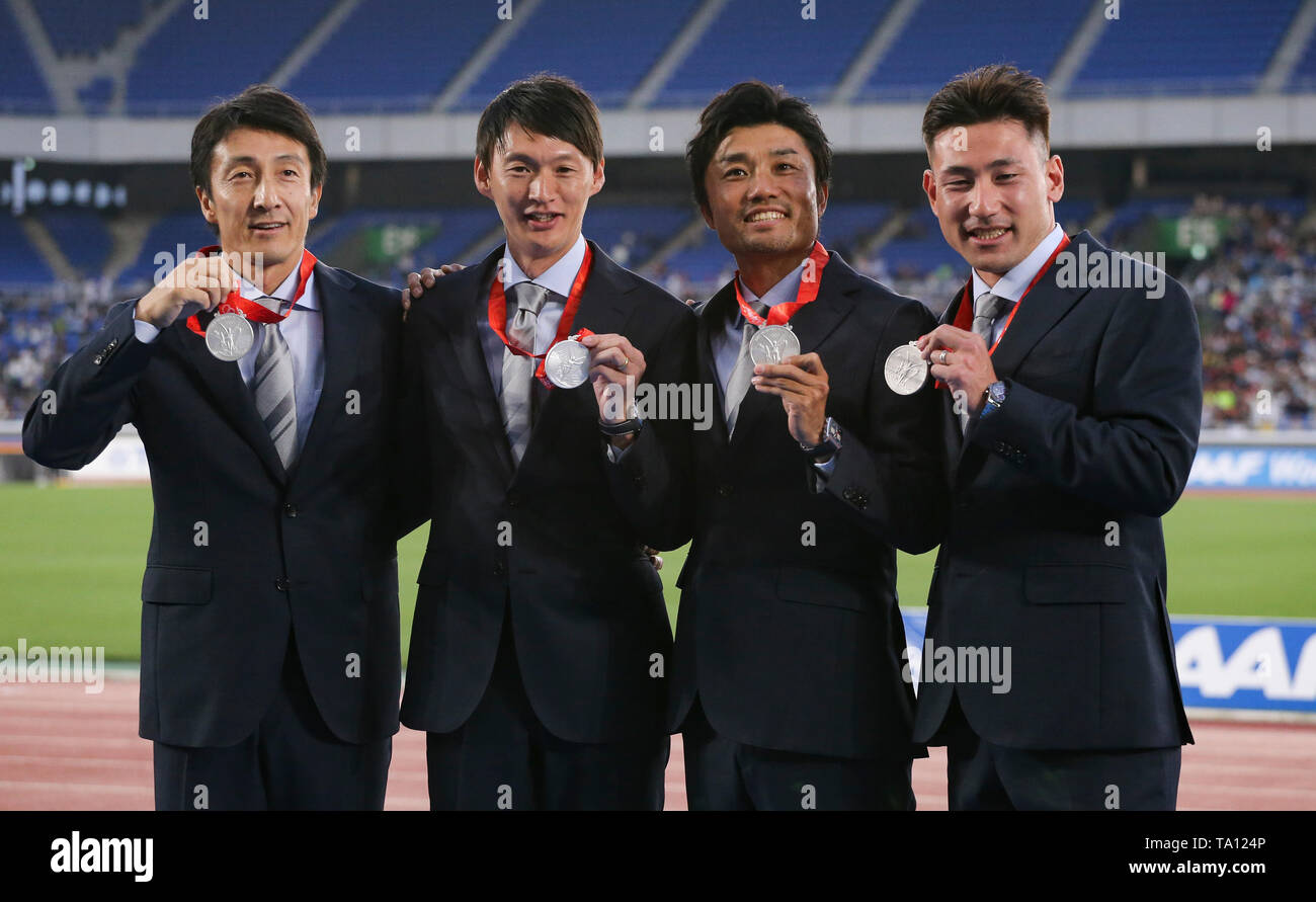 YOKOHAMA, JAPAN - MAY 12: The session began with a medal reallocation ceremony for the men's 4x100m relay from the 2008 Olympics during which the Japanese quartet of Naoki Tsukahara, Shingo Suetsugu, Shinji Takahira and Nobuharu Asahara received the silver medal after being elevated to second place after Jamaica's disqualification. during Day 2 of the 2019 IAAF World Relay Championships at the Nissan Stadium on Sunday May 12, 2019 in Yokohama, Japan. (Photo by Roger Sedres for the IAAF) - Stock Image