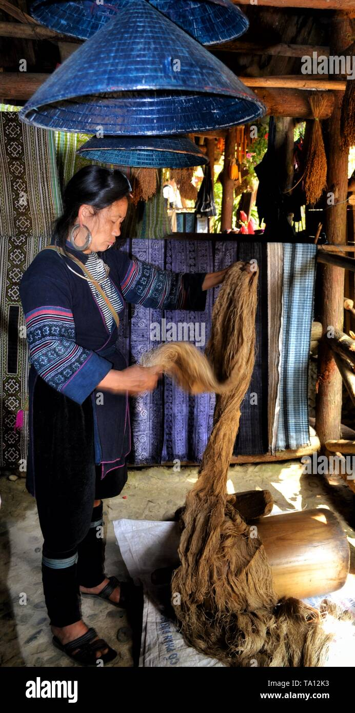 Hmong woman getting hemp ready to weave to make products with batik - Stock Image