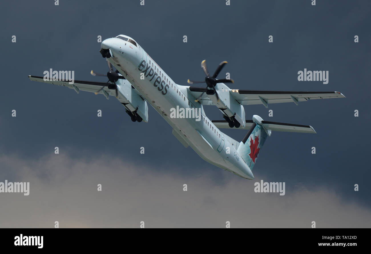 Montreal, Canada,May 20, 2019 Air Canada Express taking off against grey skies in Montreal,Quebec,Canada.Credit:Mario Beauregard/Alamy Live News - Stock Image
