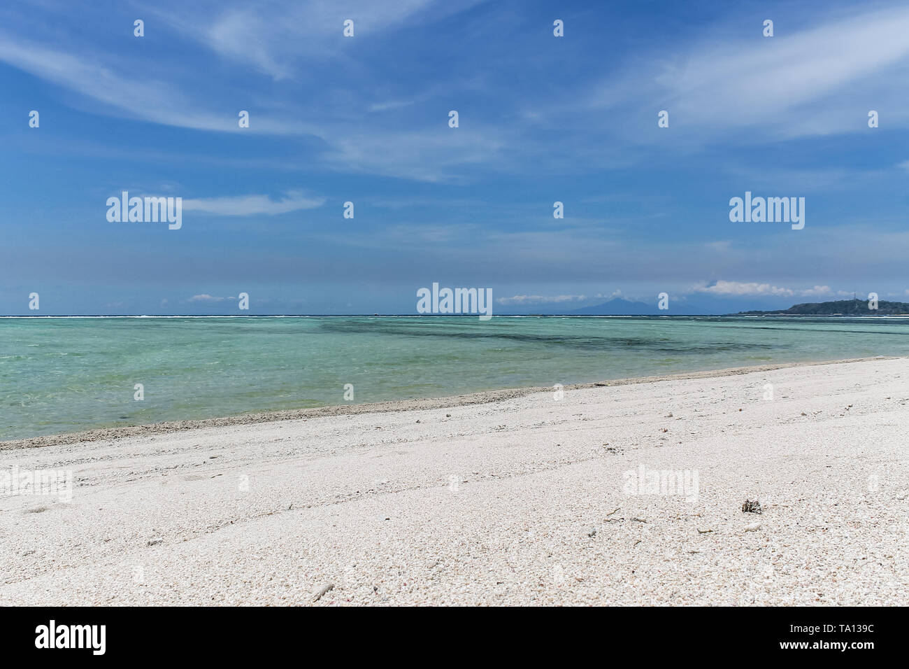 GILI AIR, INDONESIA - December 01, 2013: Pristine Waters and a white Sandy Beach on Gili Air. One of the three popular Gili Islands near Lombok. - Stock Image
