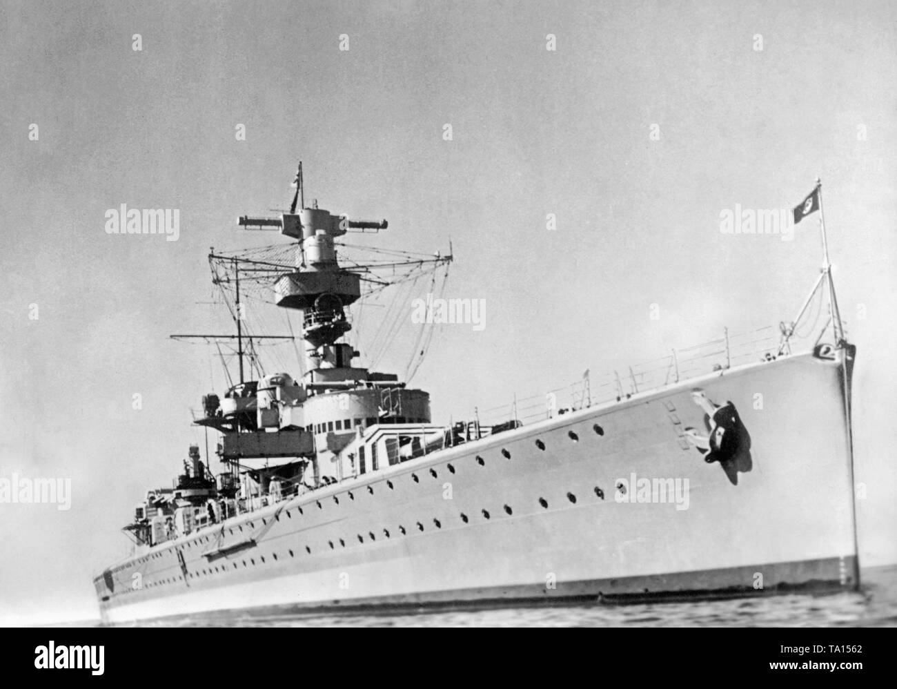 Photo of the heavy cruiser 'Luetzow' in January, 1940. In the autumn of 1940,'Deutschland' was renamed'Luetzow' (after Prussian general Adolf von Luetzow). It took part in the occupation of Norway after a general overhaul in the Gdansk shipyard in April, 1940. Aswastika flag is blowing at the bow. - Stock Image