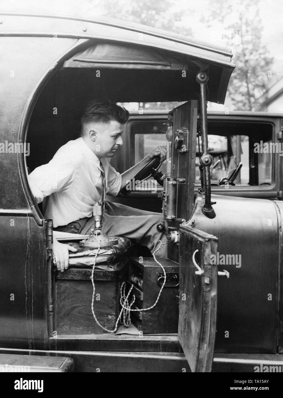 An employee of the Bureau of Standards in Washington tests trucks for their suitability for conversion to ambulances. The suspension comfort is checked with the help of a specially made device. Stock Photo