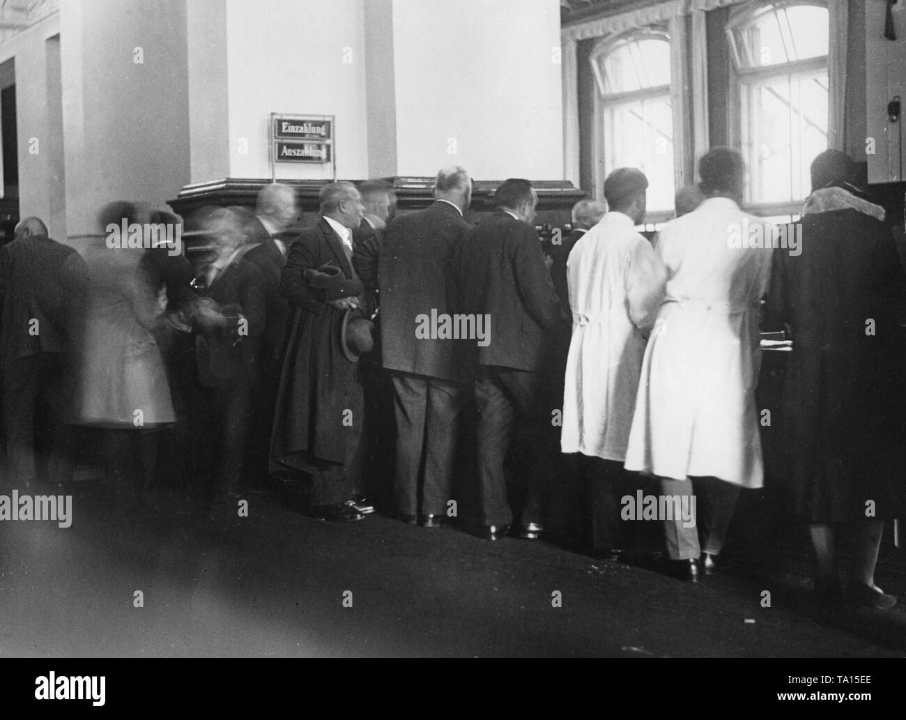 After the banking crisis, triggered by the insolvency of the DANAT bank (Darmstaedter and Nationalbank), many panicked depositors rush the counters. - Stock Image