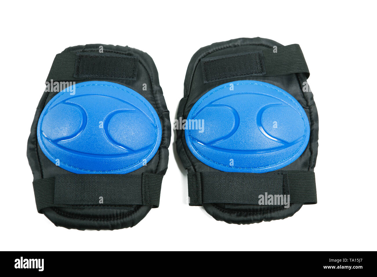 Knee pads and elbow pads isolated on white background - Stock Image