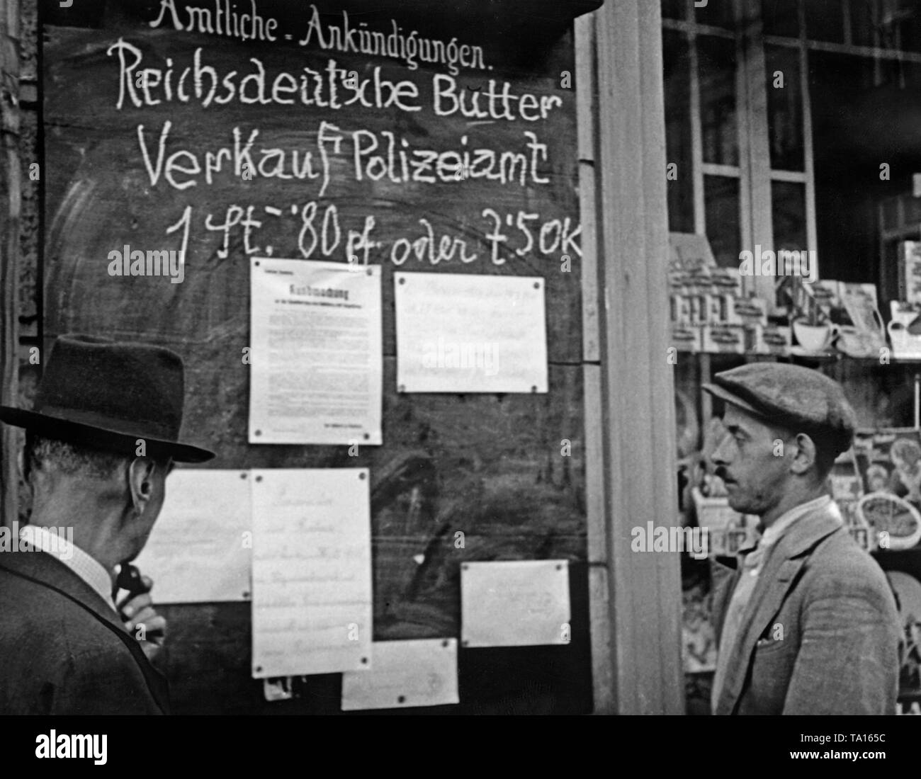 On a bulletin board after the occupation of the Sudetenland by Germany: 'Official announcements. Butter from the German Reich. Sale Police Office. 1 piece - 80 pf. or 7'5 OK '. Below, some written notes attached. - Stock Image