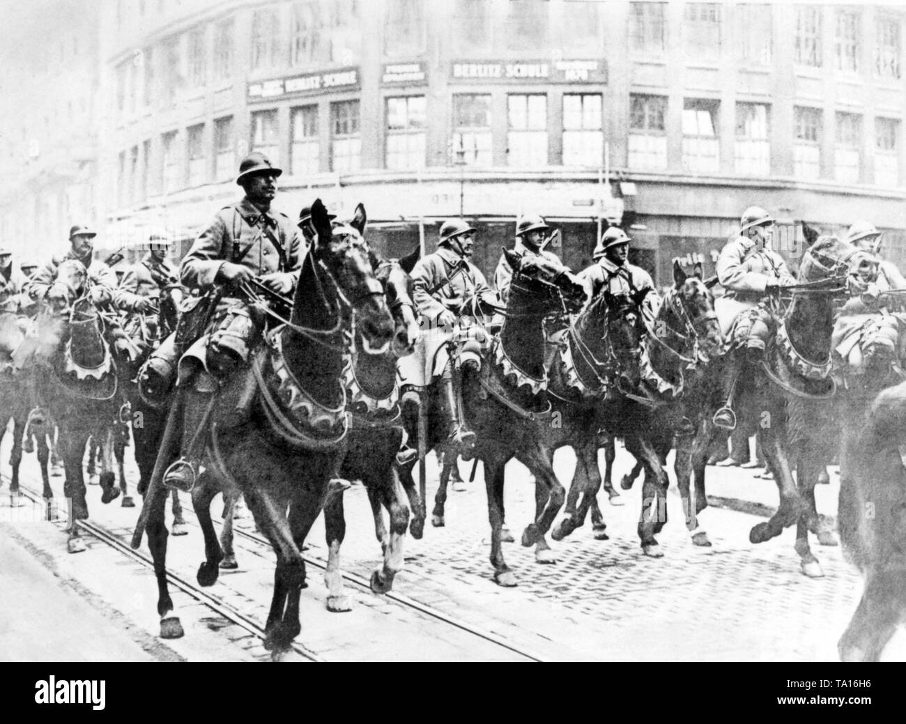 French cavalry units march in Essen as part of the occupation army. - Stock Image