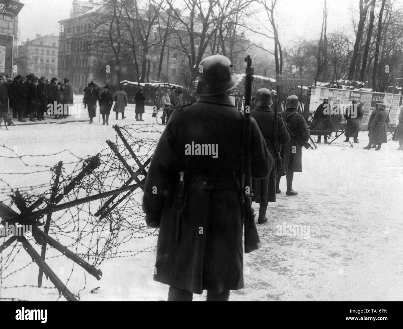 Policemen block with barbed wire the Blutenburg and Marsstrasse, which lead to the Infantry School. There took place the trial against the participants of the Hitler putsch. Stock Photo