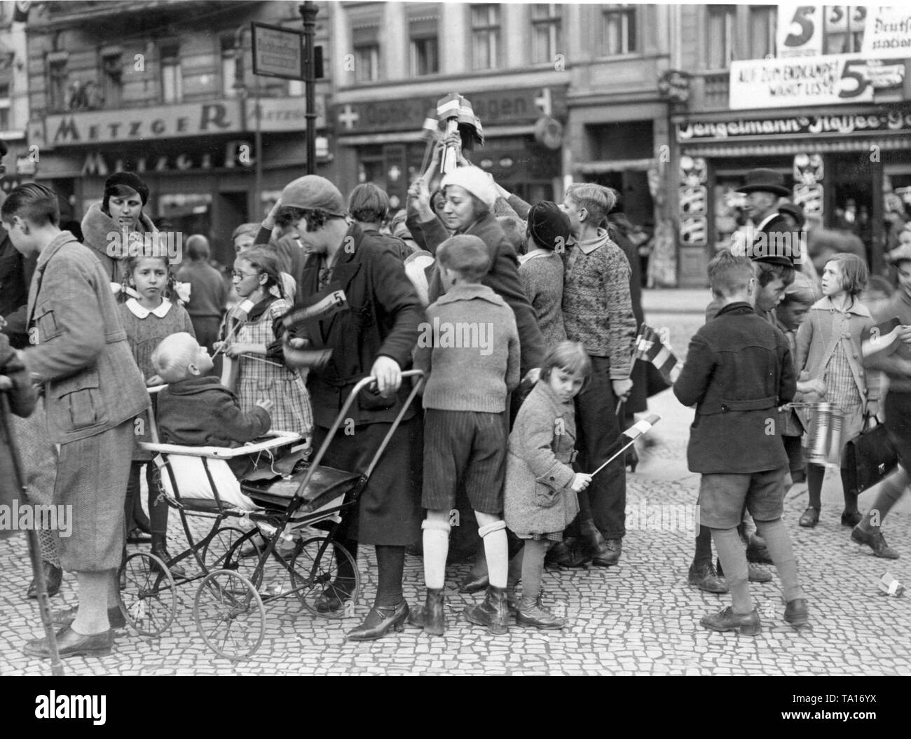 As an election campaign, the Bismarck Youth distributes black-white-red flags in front of an agency in the borough of Neukoelln. - Stock Image