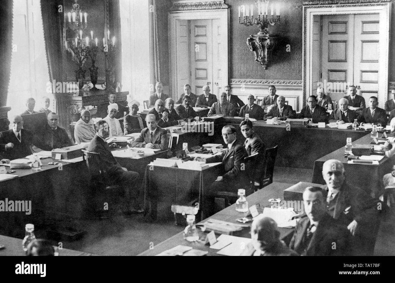 This shot shows the Indian Round Table Conference at St. James's Palace in London. Third from the left on the conference table Mahatma Gandhi, on the left next to him the chairman Lord Sankey. Gandhi was nominated several times for the Nobel Peace Prize during his lifetime. Stock Photo