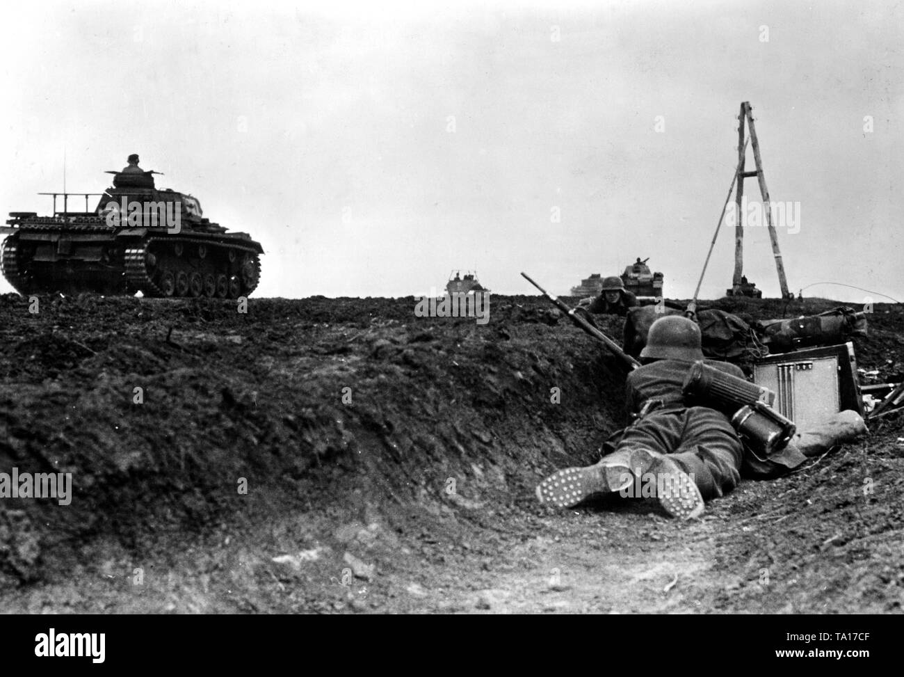 Station in a road ditch during battles in the southern section of the Eastern front. On the road is a Panzer III. War correspondent: Stock Photo