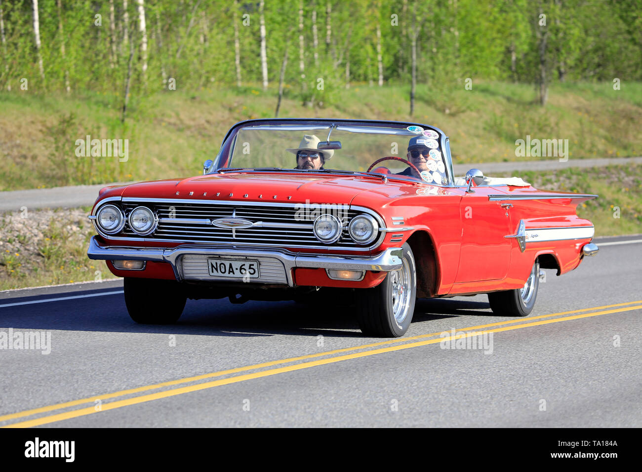 Salo, Finland. May 18, 2019. Classic 1960s red Chevrolet Impala Convertible on the road on Salon Maisema Cruising 2019. - Stock Image