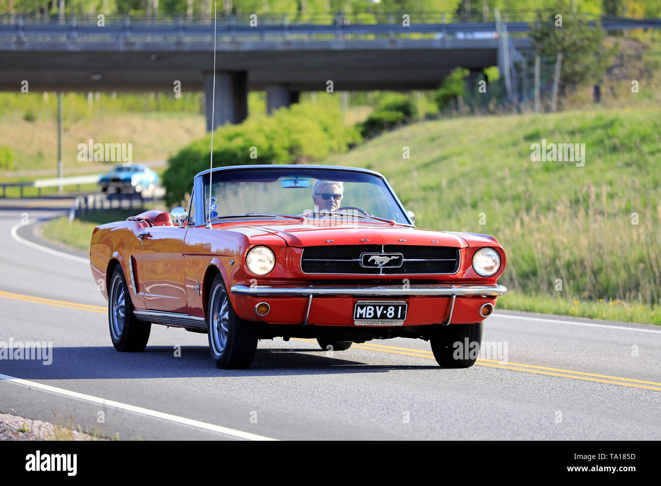 Salo, Finland. May 18, 2019. Classic 1960s red Ford Mustang convertible on the road on Salon Maisema Cruising 2019. - Stock Image