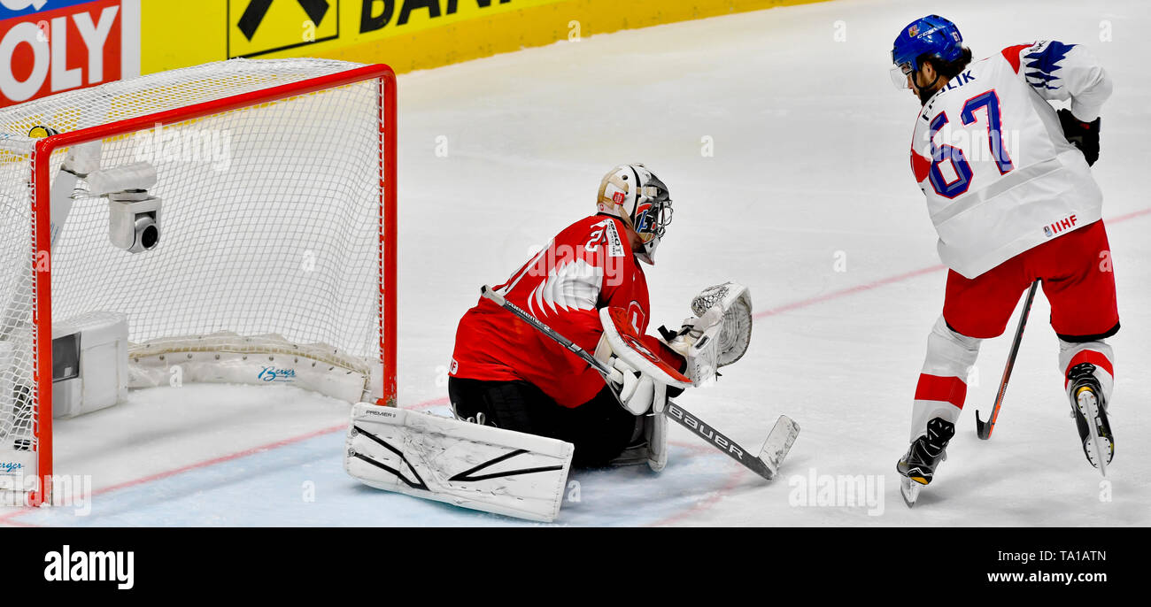 L-R Michael Frolik (CZE) scores goal over Reto Berra (SUI) during the match between Czech Republic and Switzerland within the 2019 IIHF World Championship in Bratislava, Slovakia, on May 21, 2019. (CTK Photo/Vit Simanek) - Stock Image