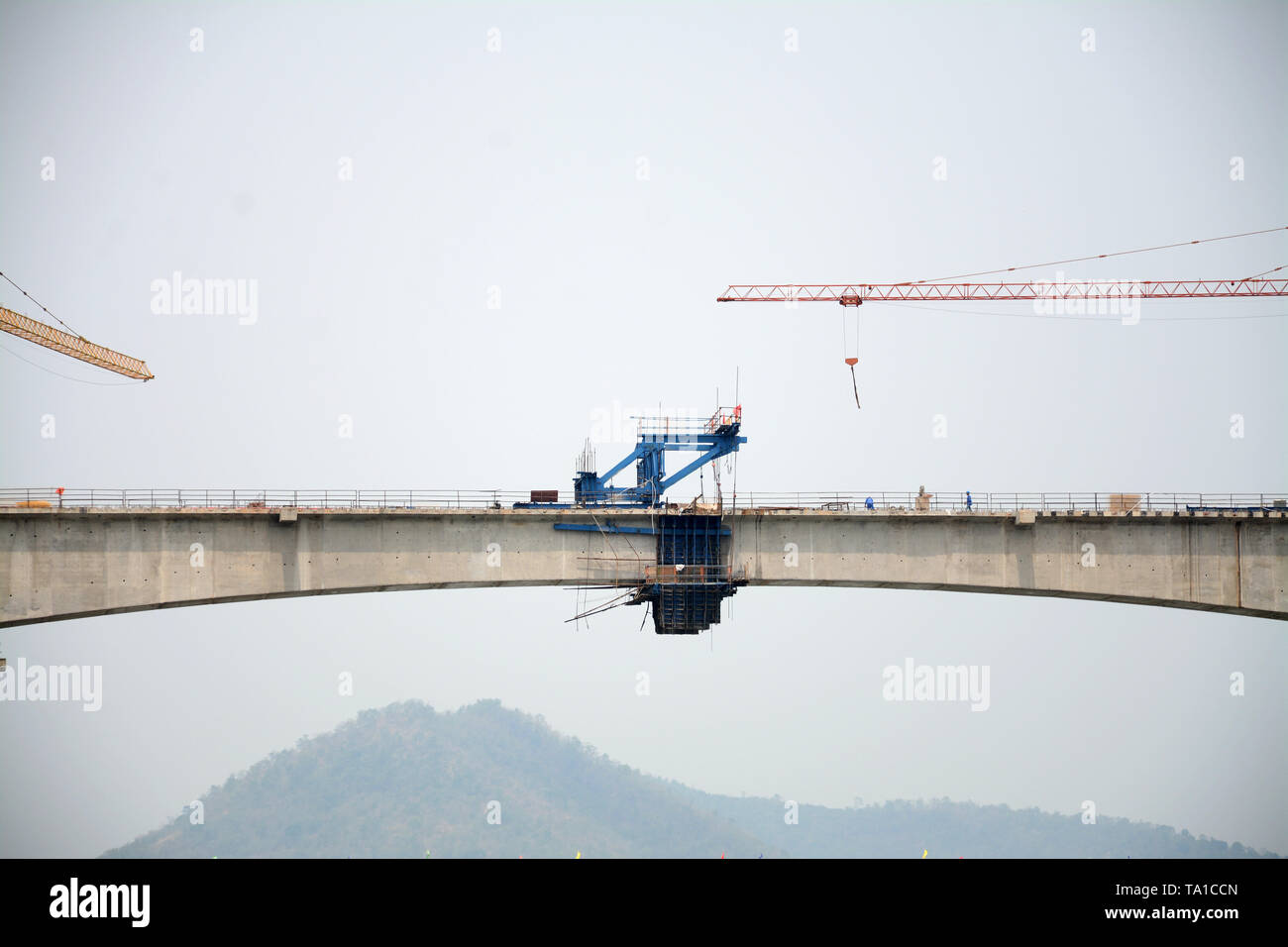 (190521) -- LAOS, May 21, 2019 (Xinhua) -- Photo taken on May 21, 2019 shows the Luang Prabang cross-Mekong River railway bridge in northern Laos. The first bridge span of the China-Laos railway has been built over the Mekong River in northern Laos, the Laos-China Railway Co., Ltd., which is in charge of the construction and operation of the railway said on Tuesday. Accordingly, the China Railway No. 8 Engineering Group (CREC-8) has completed the closure of the first span of the Luang Prabang cross-Mekong River railway bridge on Saturday. It is also the first completed bridge span of two cross - Stock Image