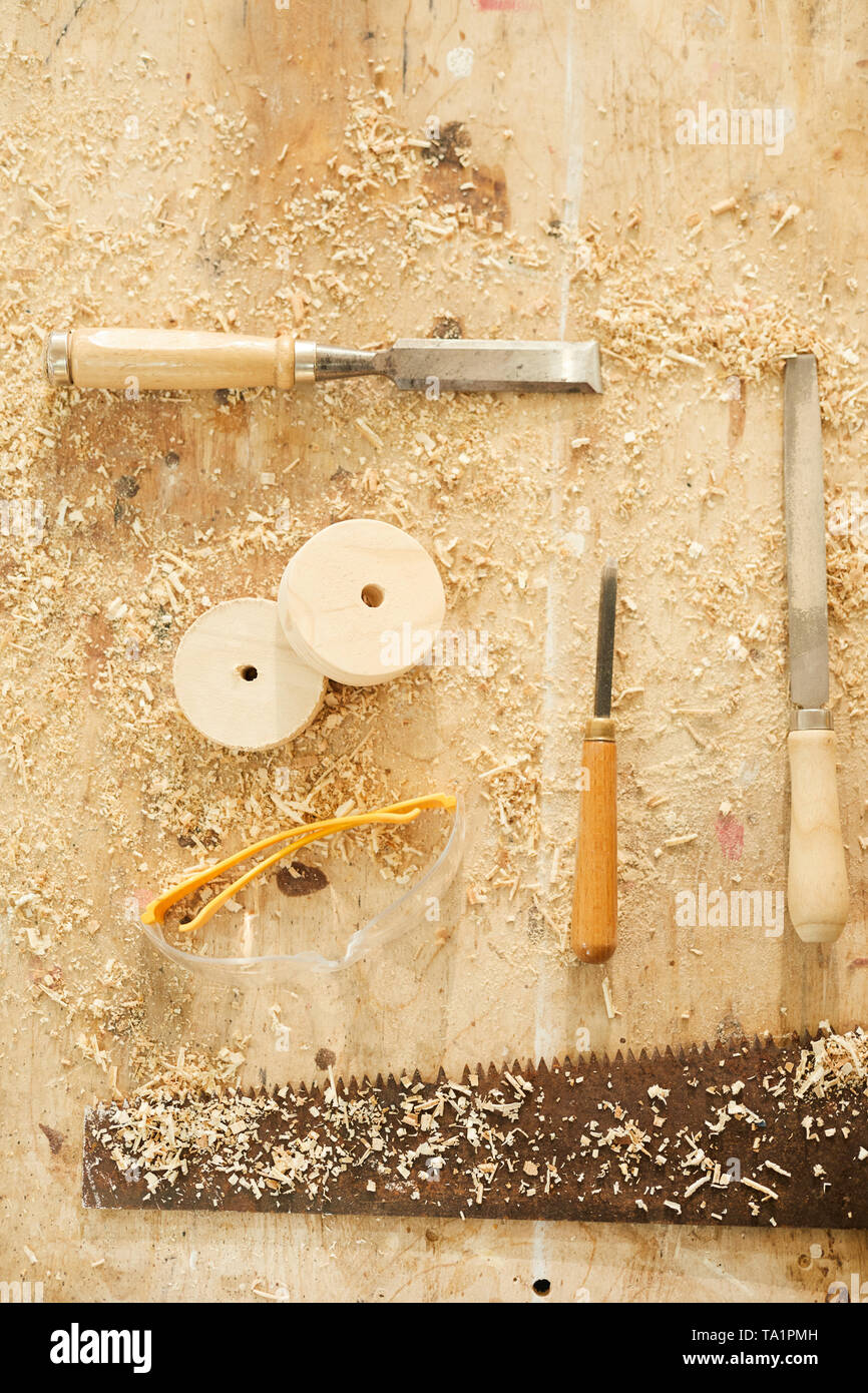 Background of carpenters tools on table in workshop dusted with wood shavings, copy space - Stock Image