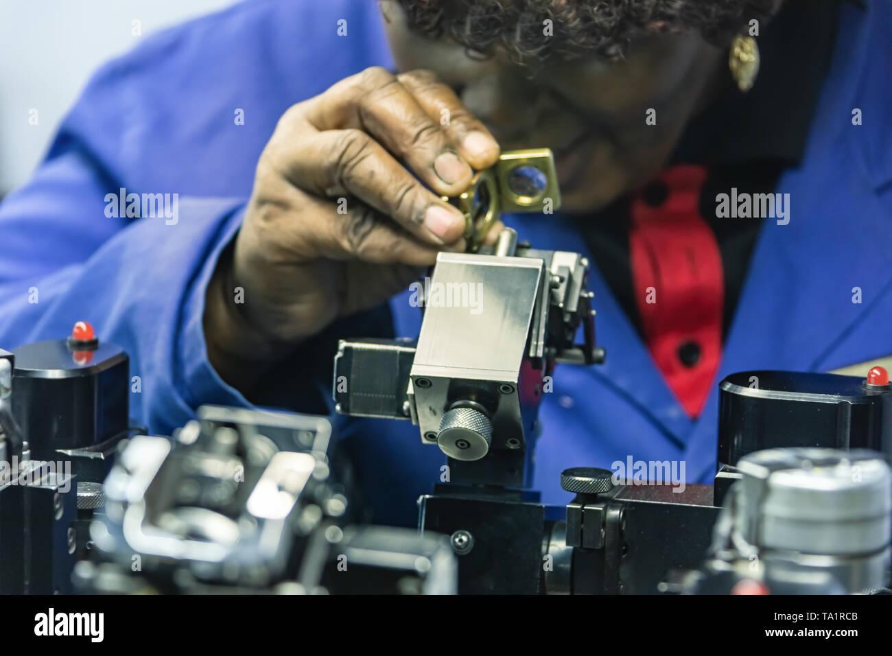 Machines to polish diamonds, grading diamonds, african woman working. In Africa , Botswana Stock Photo