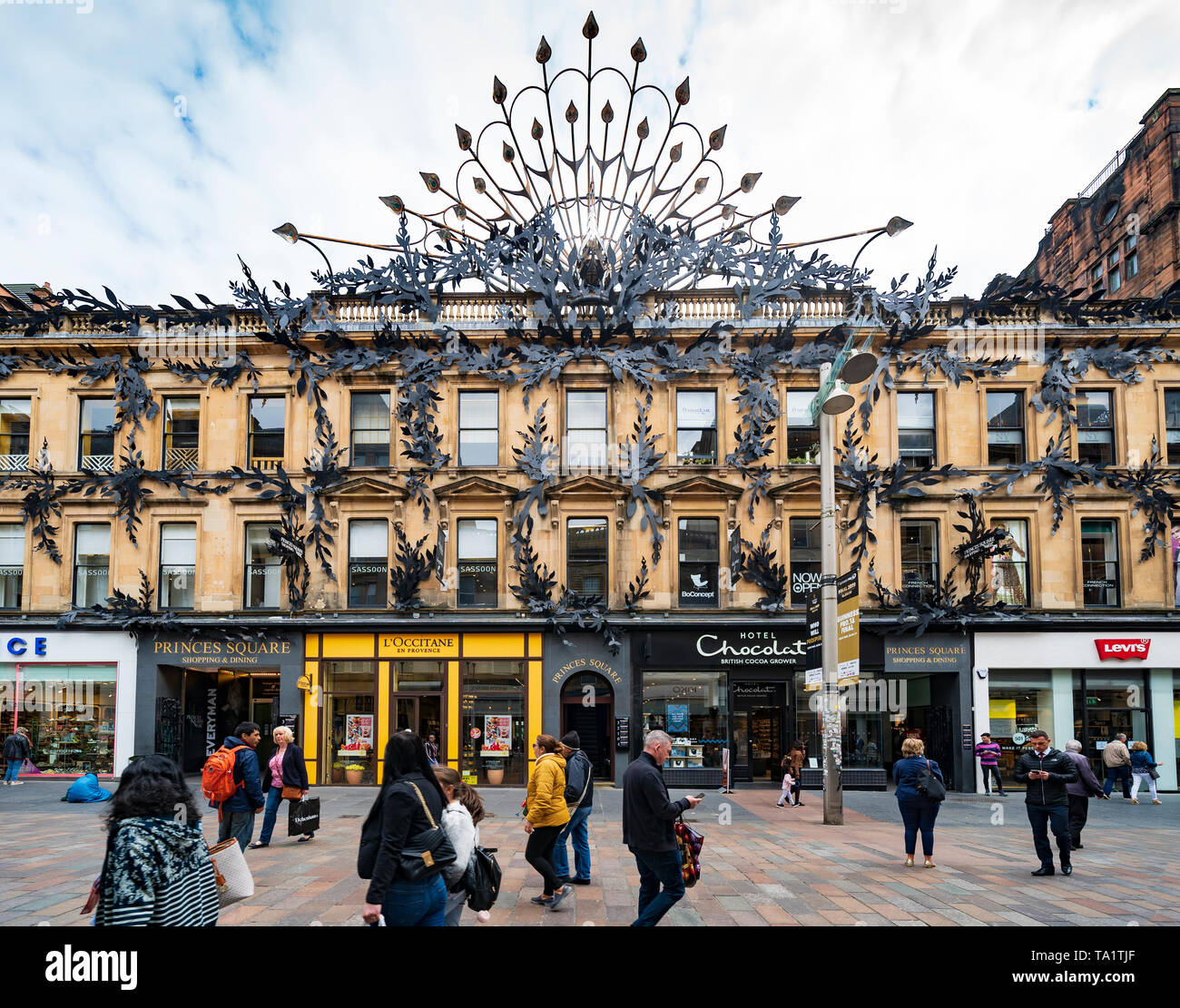 View of shoppers and shops at Princes Square shopping centre on Buchanan Street the main pedestrian shopping street in Glasgow, Scotland, UK - Stock Image