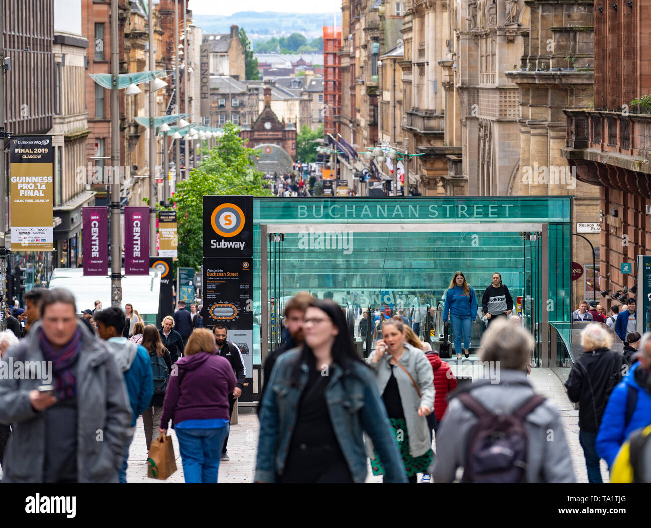 View of shoppers and shops on Buchanan Street the main pedestrian shopping street in Glasgow, Scotland, UK - Stock Image