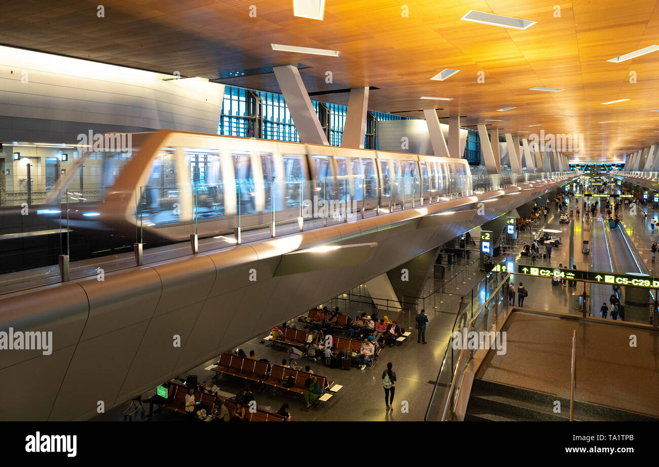 Elevated passenger shuttle train in terminal building at Hamad International Airport in Doha, Qatar Stock Photo