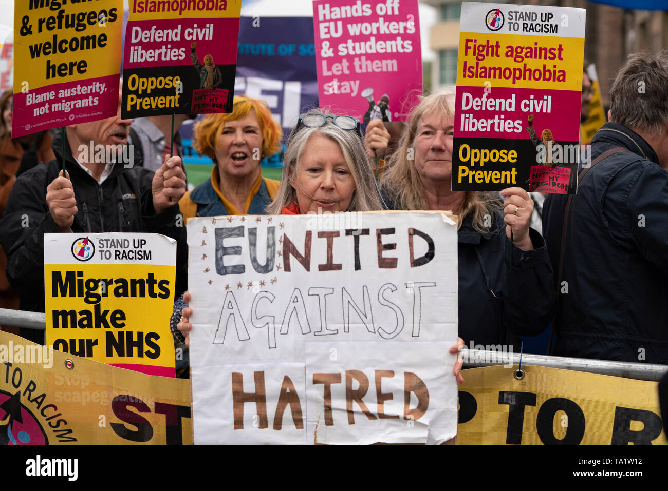 Protestors at meeting of Brexit Party before European Elections with speaker Nigel Farage in Edinburgh, Stock Photo