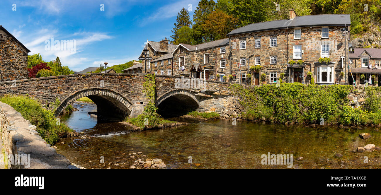 Beddgelert Gwnedd Wales May 13, 2019 Attractive stone buildings beside the river Glaslyn, in Beddgelert, in the Snowdonia National Park Stock Photo