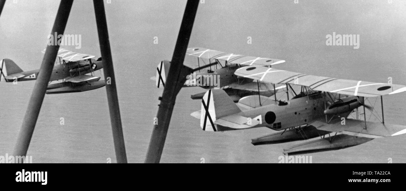 Photo of a group of Heinkel He 59 recon aircrafts of the 89th Seefliegerstaffel (naval pilot squadron) of the Condor Legion over the Mediterranean Sea at Mallorca. The aircrafts are carrying the cockades of the Condor Legion and the Saint Andrew's Cross (vertical tail) of the Spanish Air Force. The squadron was stationed in the Port de Pollenca in Mallorca, and it was supposed to protect German merchant ships. - Stock Image