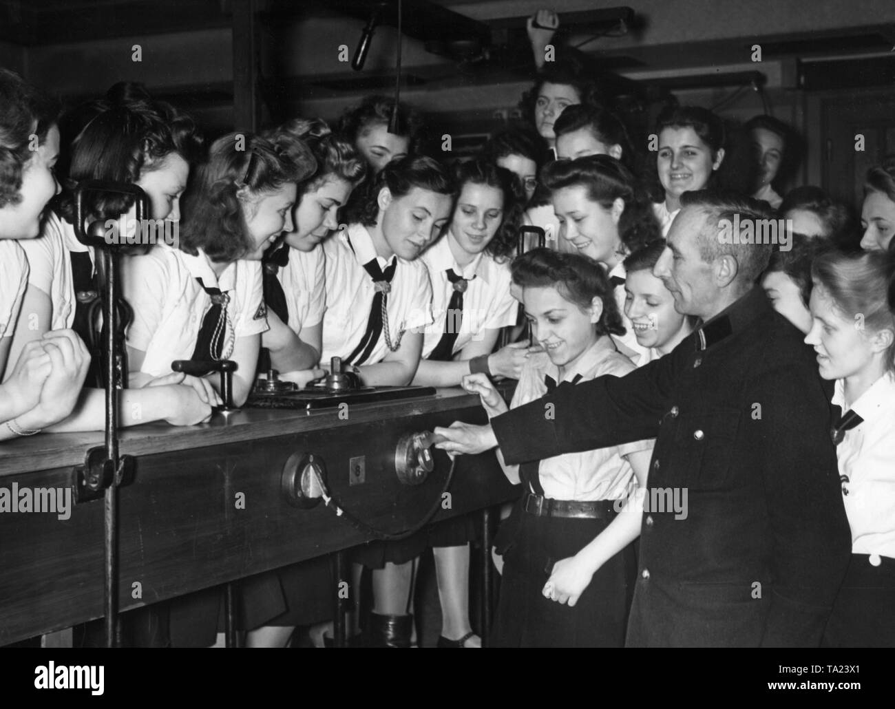 BDM girls as conductors deployed by the Berlin transportation company. Here they are instructed in the suspending of a brake cable in the dummy coupling. - Stock Image