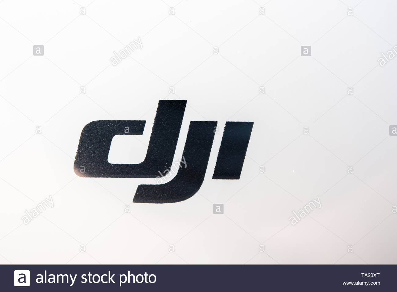 Sign logo of a DJI Phantom drone over the white plastic of the air vehicle. The branding design is illuminated with natural light Stock Photo
