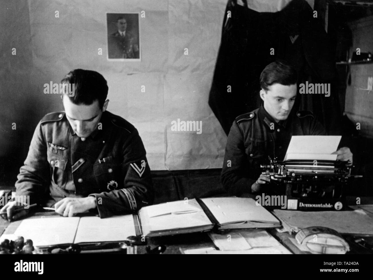 Two German soldiers are sitting in the office of a battalion command post southeast of Lake Ilmen. They probably belong to the Infantry Regiment 271 / 'Feldherrnhalle'. Photo of the Propaganda Company (PK): war correspondent Elle. - Stock Image