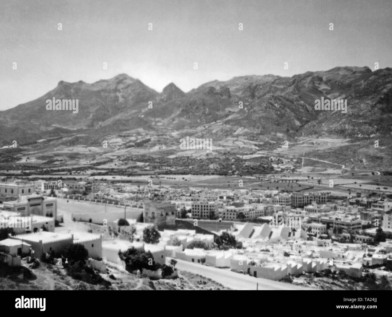 Photo of the city of Tetouan on the mediterranean coast of Spanish Morocco. In the background, foothills of the Atlas Mountains. This was the place where German Junkers Ju 52 transport aircrafts with the paintwork of the German Condor Legion started their flight loaded with Moroccan soldiers to the Spanish mainland from. After the outbreak of the Spanish Civil War on July 27, 1936, Germany provided military assistance to General Franco (Operation Feuerzeauber). In addition, 20 Ju-52s (mostly Lufthansa aircrafts) were provided, which flew more than 800 flights of Spanish national troops, - Stock Image