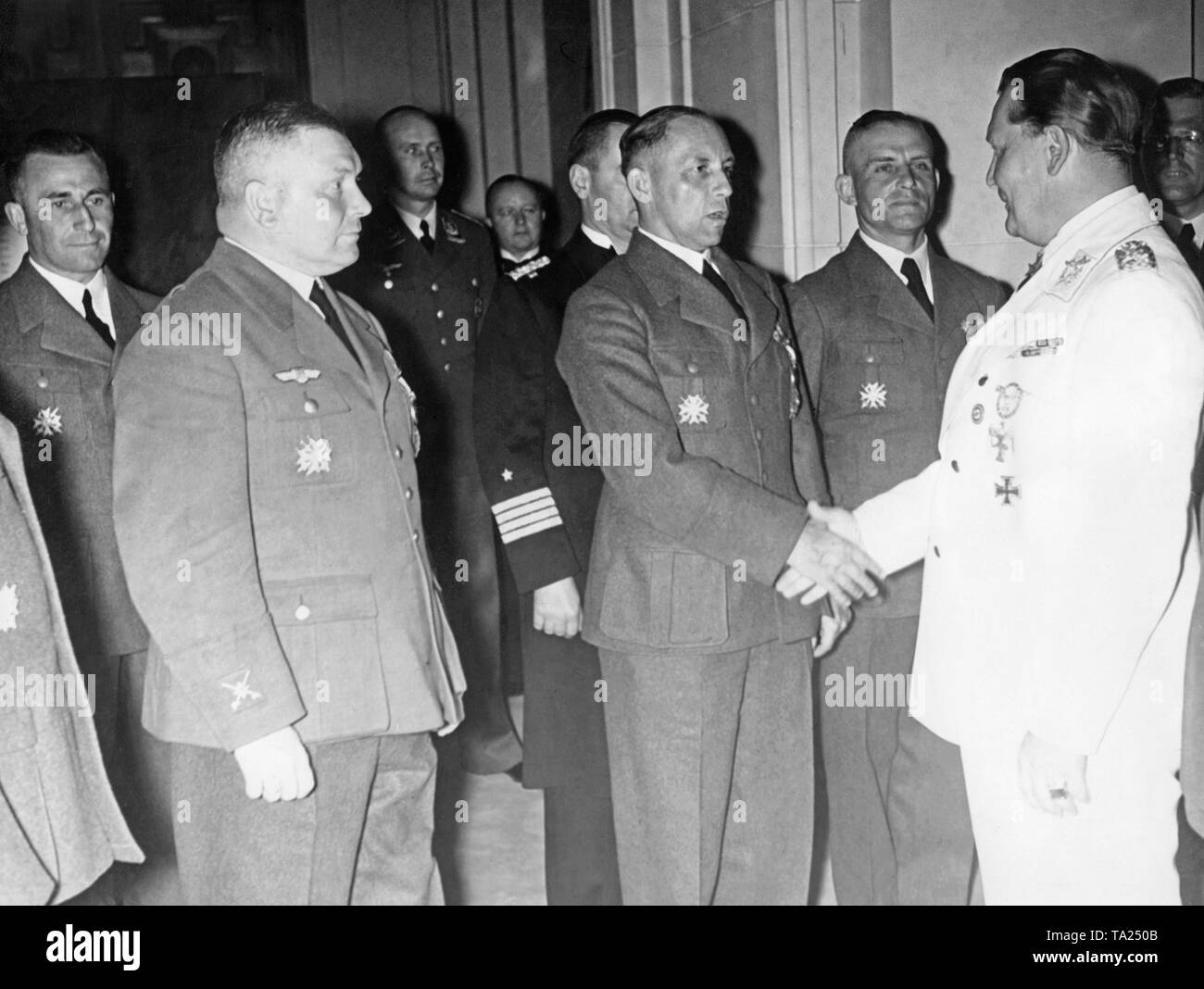 Photo of Field Marshal General, Hermann Goering (right), at the reception of officers of the Condor Legion who returned from the Spanish Civil War in the Haus der Flieger ('House of the Aviators') in Prinz Albrecht Strasse in Mitte (Berlin) on June 5, 1939. At the front on the left stands Hellmuth Volkmann, who was promoted to major general. All the officers are wearing the Spanish Cross. - Stock Image