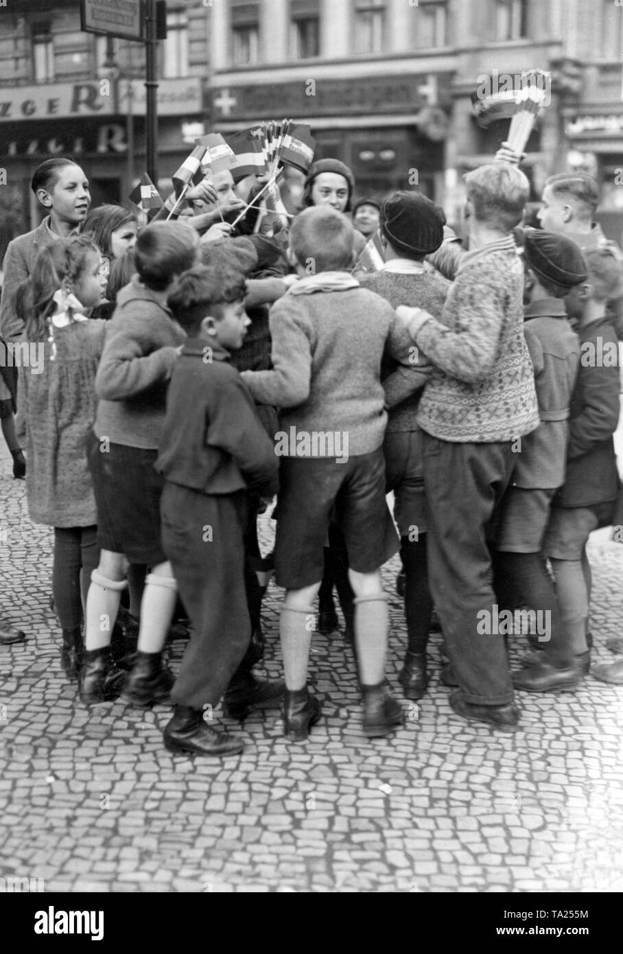 On the occasion of the Reichstag election, the Bismarck Youth distribute black-white-red flag in the borough Neukoelln, Berlin. - Stock Image