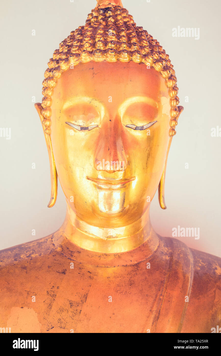 Close-up head of old buddha statue in Thailand , southeast asia culture . - Stock Image
