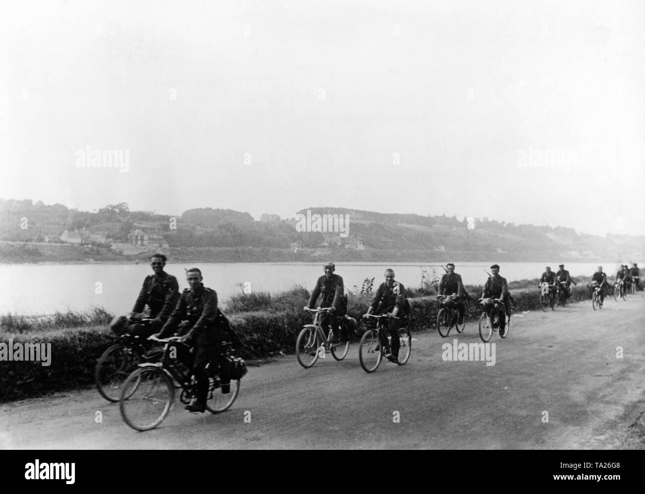 A German bicycle battalion drives along the Loire to the next unoccupied place. Stock Photo