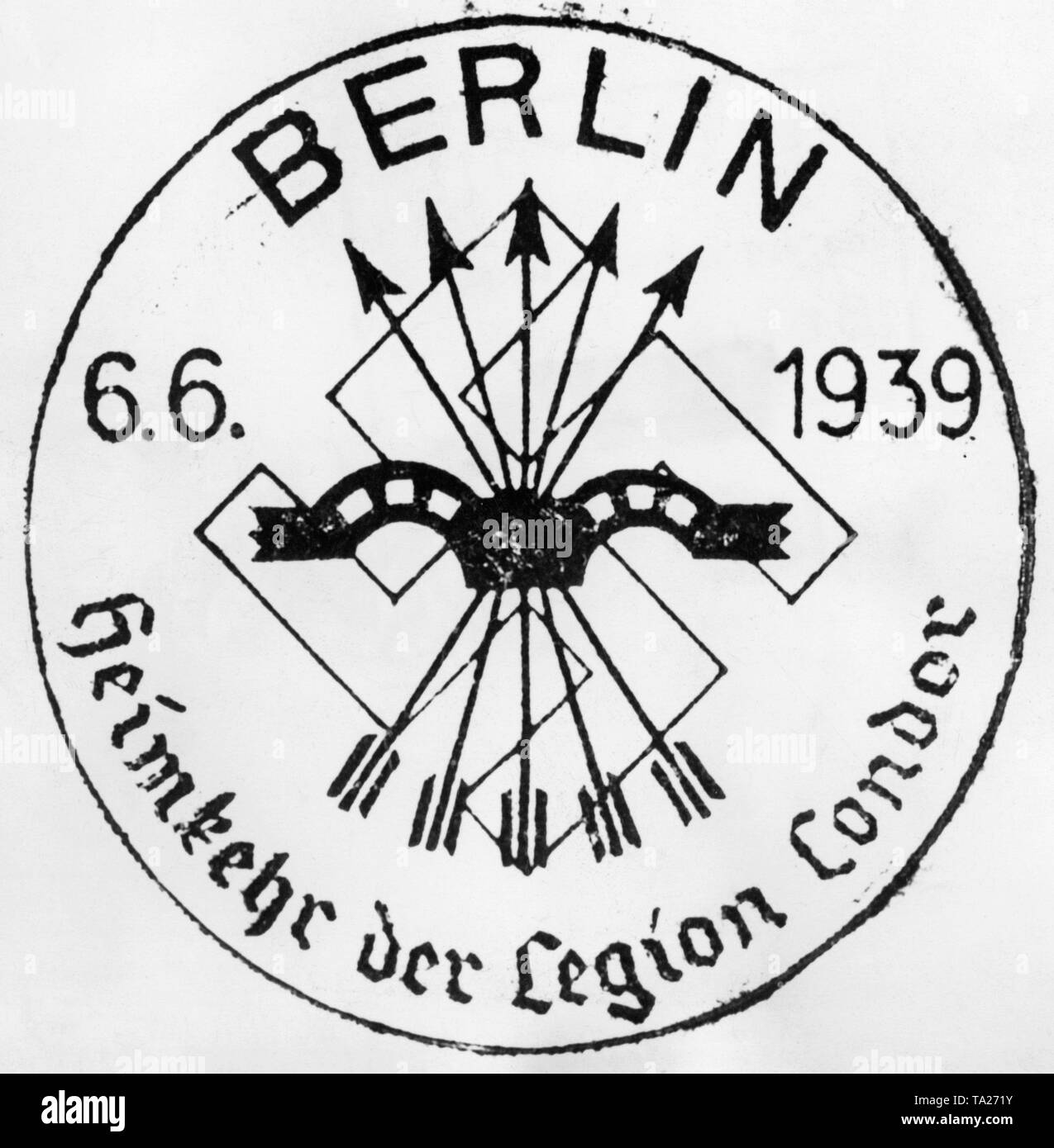 Photo of a postmark of the Reichspost on the occasion of the return of the Condor Legion from the Spanish Civil War on the 6th of June, 1939. In the center there is the symbol of the Fascist Party of Spain, the Falange (arrows and yoke), and the swastika is pictured behind it. - Stock Image