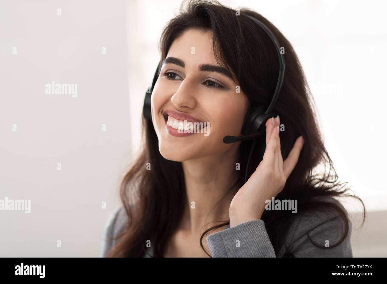 Customer service. Friendly Surrort Phone Operator At Workplace Stock Photo