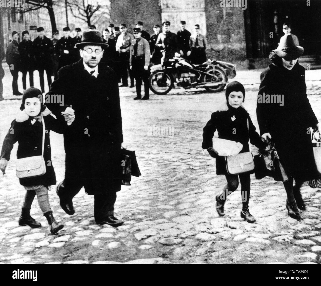 A Jewish family in Memel walk to the station packed with a few possessions, the city was occupied in March 1939 by the German troops, - Stock Image