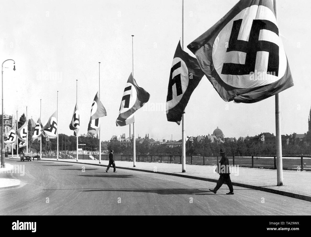 Swastika flags at half-mast in Munich on the Theresienhoehe at the fairgrounds on the occasion of the death of President Paul von Hindenburg on 2 August 1934. - Stock Image