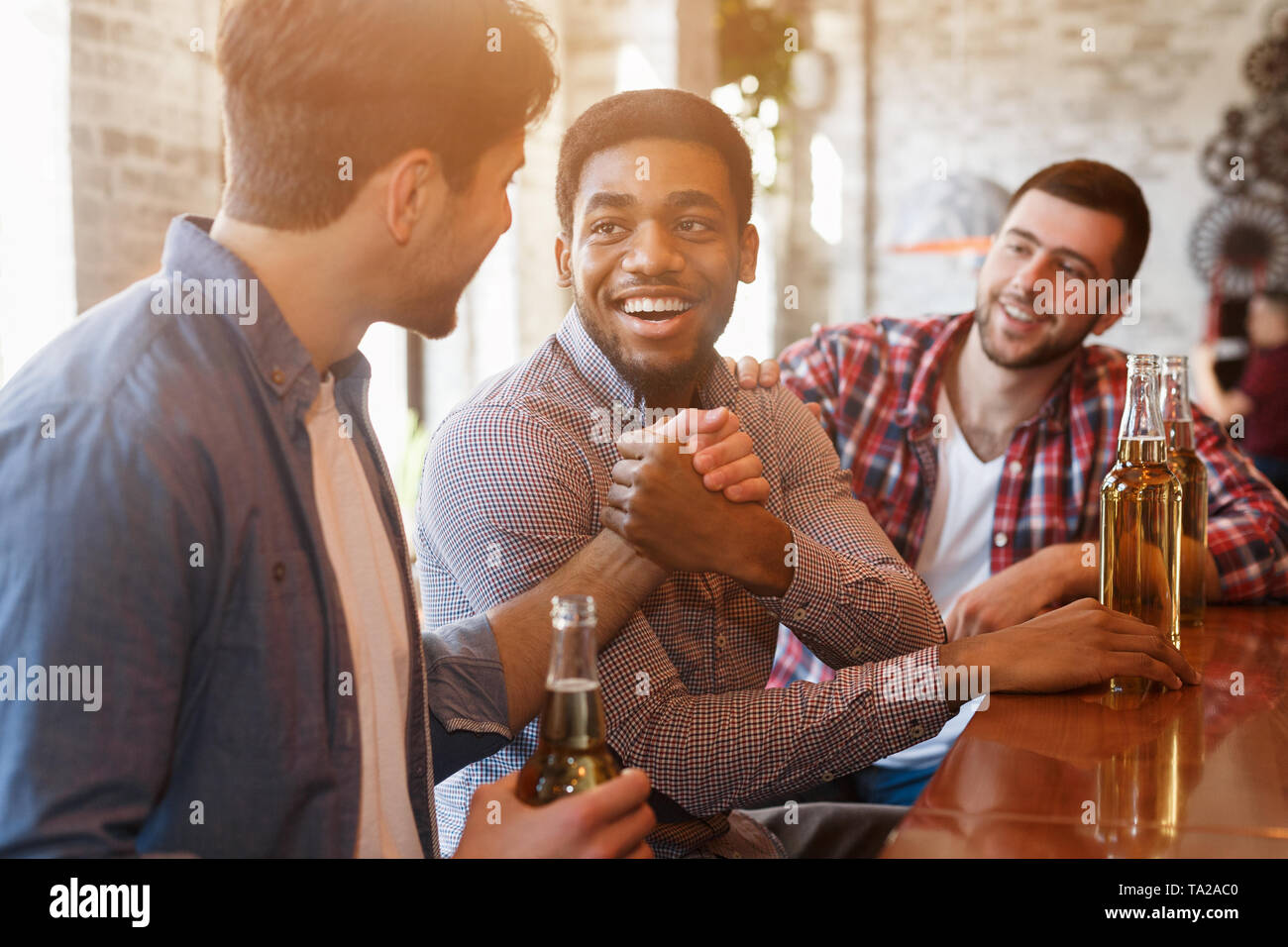 Old Friends Meeting. Mates Greeting Each Other Stock Photo